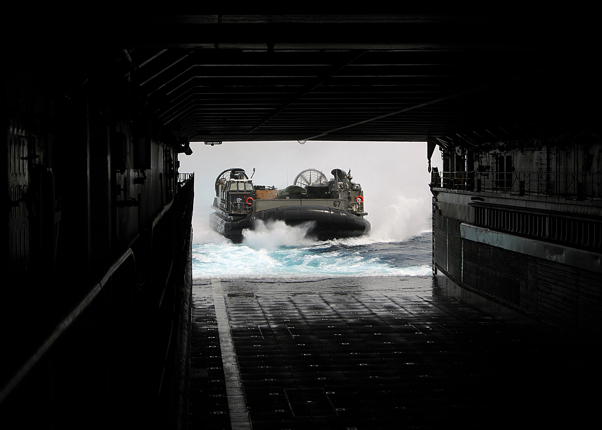 US Navy 100305-N-1082Z-009 Landing Craft Air Cushion (LCAC) 67, assigned to Assault Craft Unit (ACU) 4, approaches the well deck of the amphibious dock landing ship USS Ashland (LSD 48)
