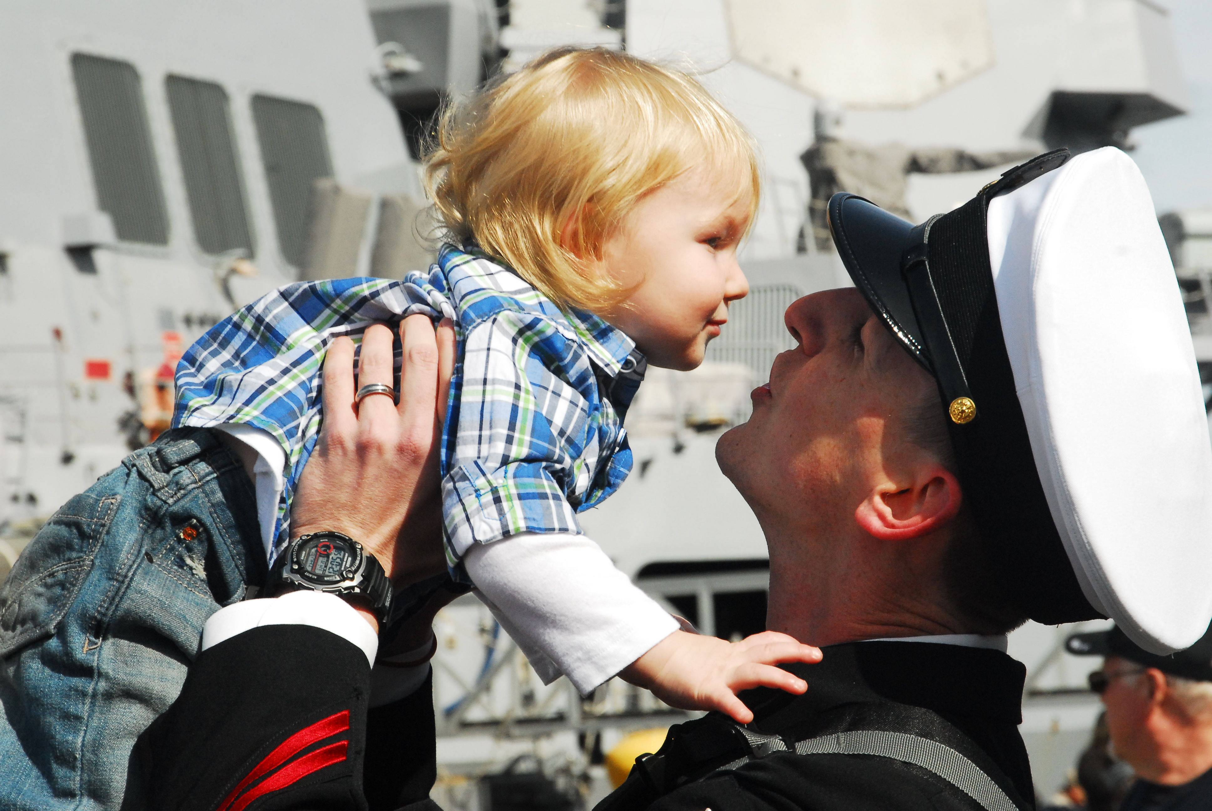 US Navy 110324-N-QW737-009 A chief petty officer greets his child upon arriving home aboard the aircraft carrier USS Abraham Lincoln (CVN 72)