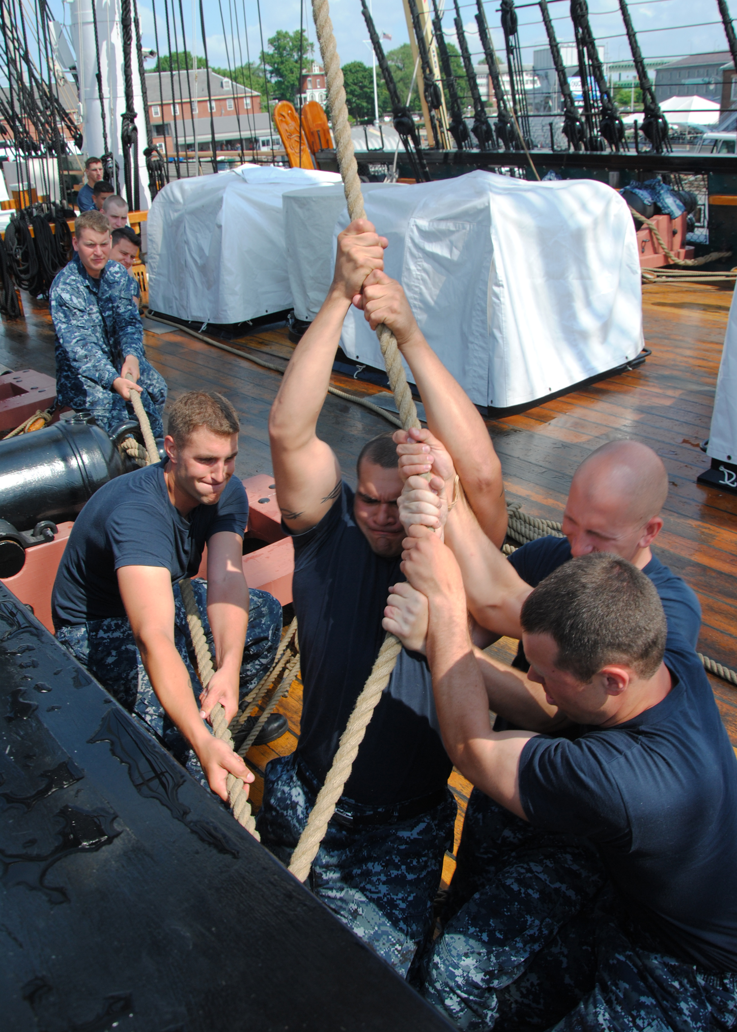 US Navy 110629-N-SH953-468 Sailors sweat the port side halyard to the main topsail yard aboard USS Constitution for the first time since the ship b