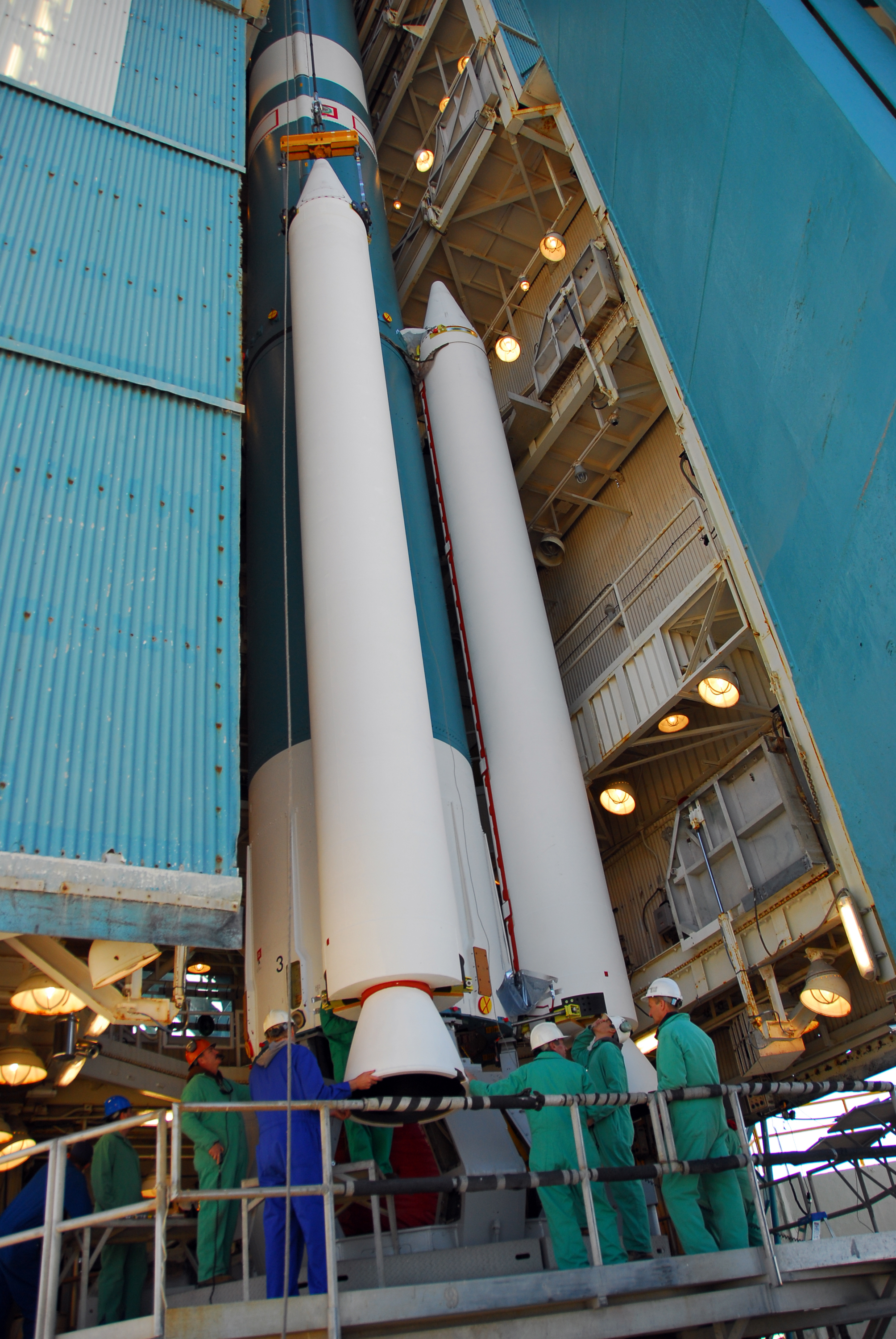 Attachment of one of three solid rocket booster to Aquarius SAC-D Delta II 7320-10C rocket