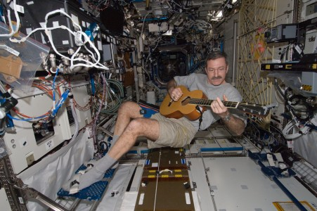 ISS-30 Dan Burbank plays a guitar in the Destiny lab