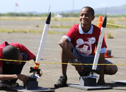 US Navy 110208-N-WP746-093 Students from Pearl Harbor Kai Elementary School prepare to launch homemade rockets at Ford Island as part of their grad