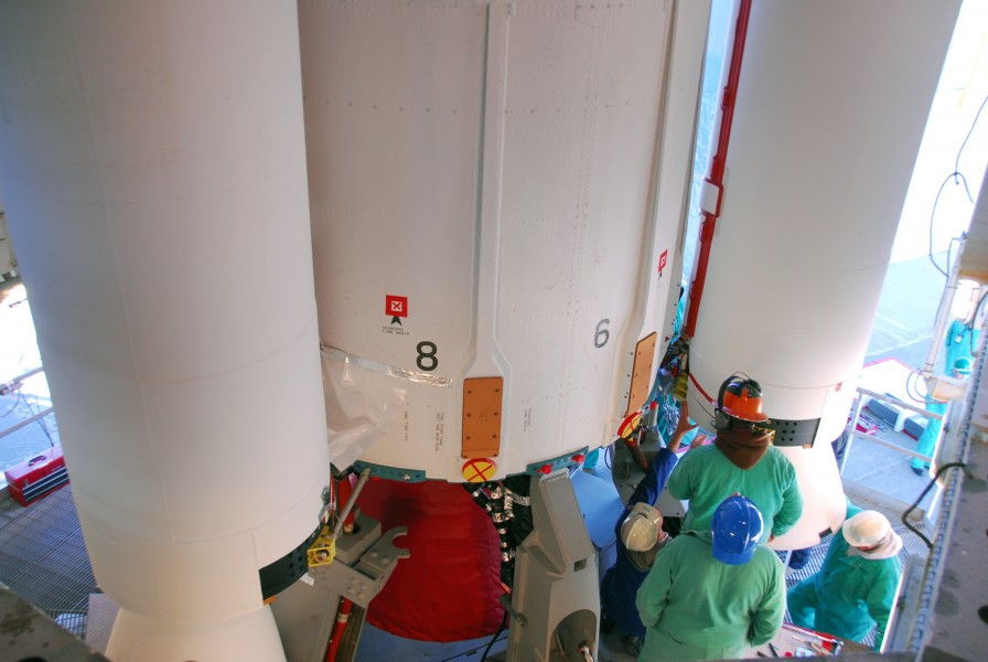 Attaching sold rocket booster to the Dlta II 7320-10C