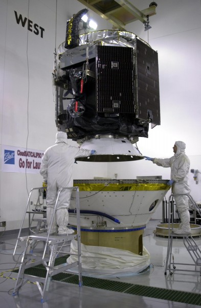 CloudSat is lowered into the lower part of the dual-payload attach fitting