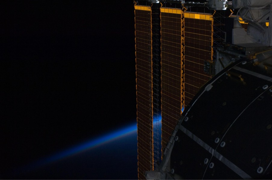 ISS solar panel intersecting Earth's horizon
