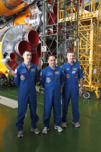 Soyuz TMA-22 crew in front of their booster rocket